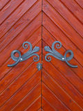 Wooden door with metal fittings. Royalty Free Stock Photos