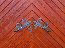 Wooden door with metal fittings. Stock Photography