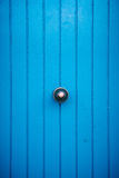 Wooden door with metal handle Royalty Free Stock Image