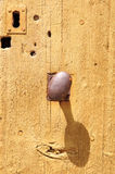 Wooden door with metal knob Royalty Free Stock Photography