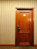 Wooden Door with metallic handle Royalty Free Stock Photography