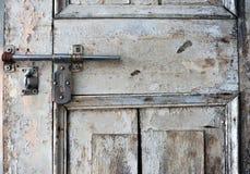 Wooden door and metallic lock Royalty Free Stock Image