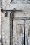 Wooden door and metallic lock Royalty Free Stock Photos