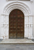 Wooden door of monastery Stock Photos