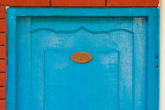 Wooden door with number sign Royalty Free Stock Photography