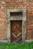 Wooden door. Old wooden door in a brick wall Stock Photos