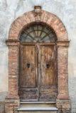 Wooden door. Old wooden door of a broken brick wall Stock Photography