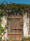 Wooden door in an old closet. Rustic charm Stock Photography