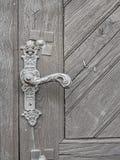 Wooden door old handle, lithuania stock photo