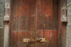 The wooden door of an old house. Stock Photos