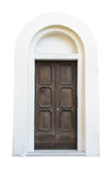 Wooden door in an old Italian house, isolated on white background. Stock Photography