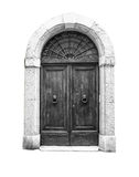 Wooden door in an old Italian house, isolated on white background, clipping path. Stock Images