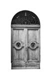 Wooden door in an old Italian house, isolated on white background, clipping path. Royalty Free Stock Photo