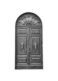 Wooden door in an old Italian house, isolated on white background, clipping path. Stock Image