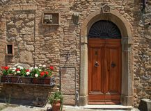 Wooden door in old Italian house, Tuscany, Italy stock photos