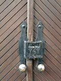 Wooden door with old lock Royalty Free Stock Image