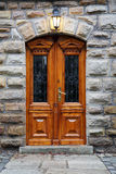 Wooden door in an old mansion Stock Photo