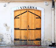 Wooden door of an old Prague wine-house. Shabby wooden door of an old Prague wine-house Royalty Free Stock Photography