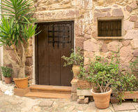 Wooden door in an old Spanish house Stock Photos