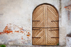 Wooden door in an old style. Courtyard of old castle Stock Photography
