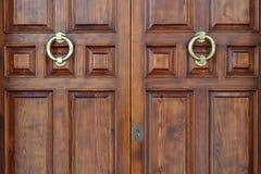 Wooden door in old style Stock Image