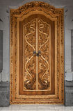 Wooden door of an old temple with carvings. Indonesia, Bali stock photo