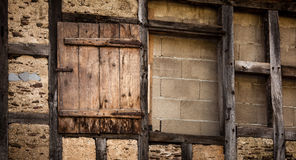 Wooden door on old wall Royalty Free Stock Image