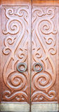 Wooden door with ornaments Stock Image