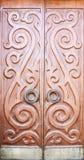 Wooden door with ornaments Stock Image
