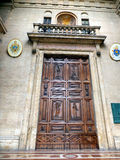 Wooden door with ornaments to the church in Assisi, Royalty Free Stock Photos