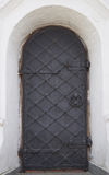 The wooden door of the orthodox church of the seventeenth century. The door latches and reinforced with iron bars royalty free stock images