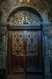 Wooden door in Orthodox Church. Wood carving technic. Vertical photo Stock Photography