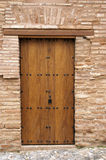 Wooden door outside Alhambra. A beautiful wooden door outside the Alhambra in Granada, Spain royalty free stock image