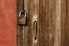 Wooden door with padlock Royalty Free Stock Photography