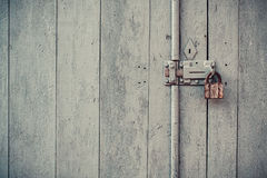 Wooden door with padlock Stock Photo