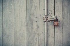 Wooden door with padlock. Closeup vintage old wooden door in grungy style with padlock stock photo