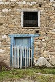 Blue door and stone wall royalty free stock photography