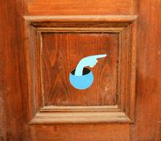 Wooden door with painted hand. Wooden door with painted blue hand pointing to the right Royalty Free Stock Image