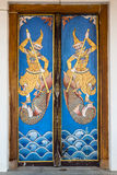 Wooden door painting. Ancient wooden door with old painting pattern is locked Royalty Free Stock Images