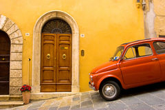 Wooden door with parked car in front Stock Images
