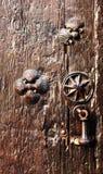 Wooden door with pilgrims scallops and knocker Stock Photos