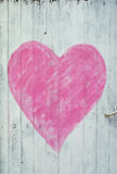 Wooden door with pink heart Royalty Free Stock Photos