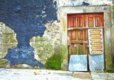 Wooden door in Portugal Stock Images