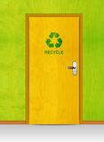 Wooden door with recycle sign Stock Photography