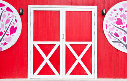Wooden door  on a red background Stock Photography