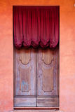 Wooden door with red curtain of medieval house Royalty Free Stock Image