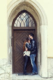 Wooden door retro couple hugging Royalty Free Stock Photography