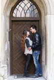 Wooden door retro couple hugging Stock Image