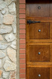 Wooden door and rock wall Royalty Free Stock Photo