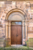 Wooden door in a romanesque stepped portal Stock Photo
